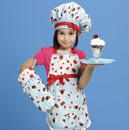 Фартук для девочки можно дополнить аксессуарами в едином стиле